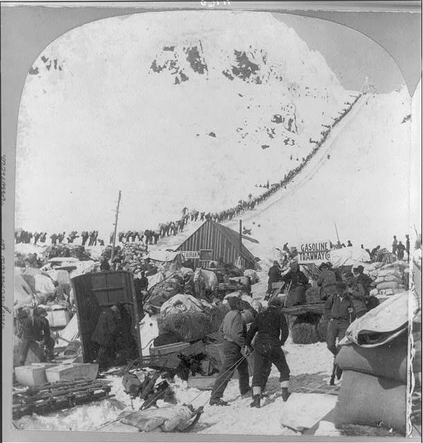 [Miners bound for the Klondike gold fields: view from bottom of Chilcoot Pass, long ribbon of climbers]