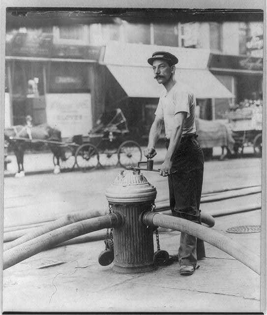 [New York City fireman turning on high pressure hoses at hydrant. July 1908]