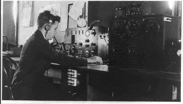 [Ham operator with his amateur radio equipment]