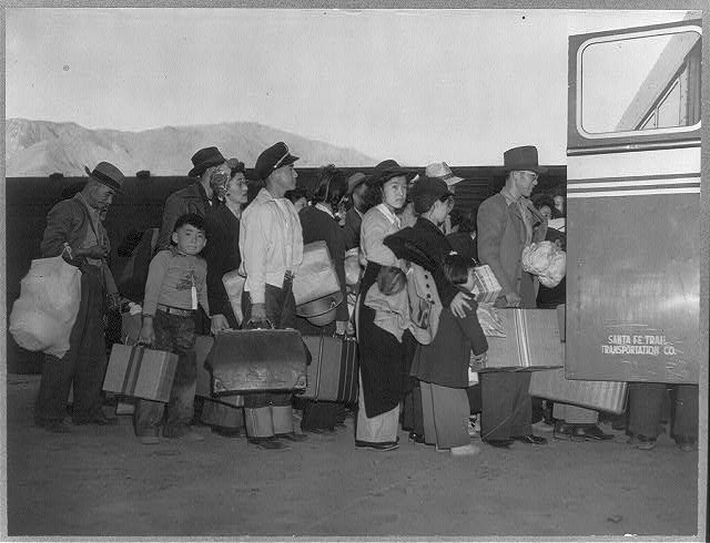 [Japanese-Americans transferring from train to bus at Lone Pine, California, bound for war relocation authority center at Manzanar]