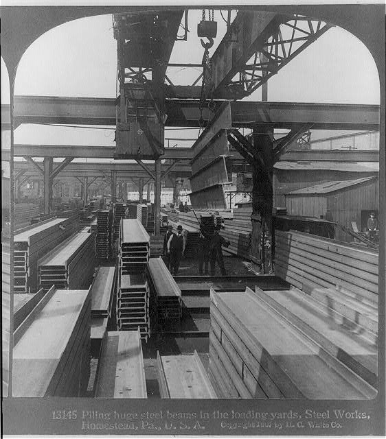 [Large cranes handling finishe steel products: piling steel beams in loading yards, Homestead, Pa. Steel Works]