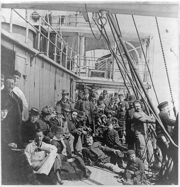 [Emigrants on the crowded lower deck of a ship, in mid-ocean]