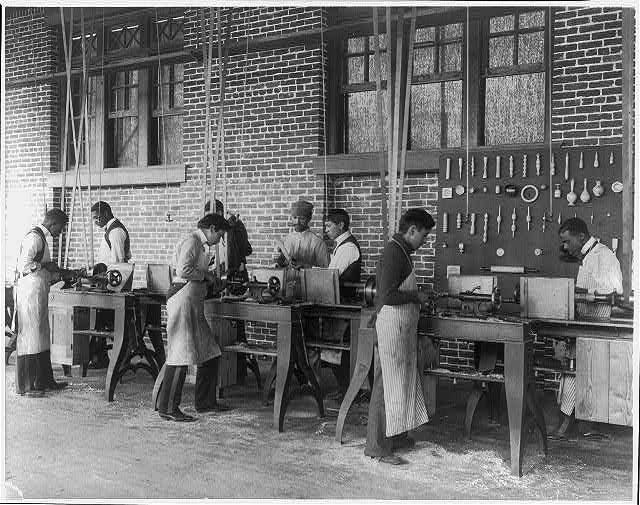 [American Indian and African American students at Hampton Institute, Hampton, Va., 1900(?) - men using machinery in woodworking shop]