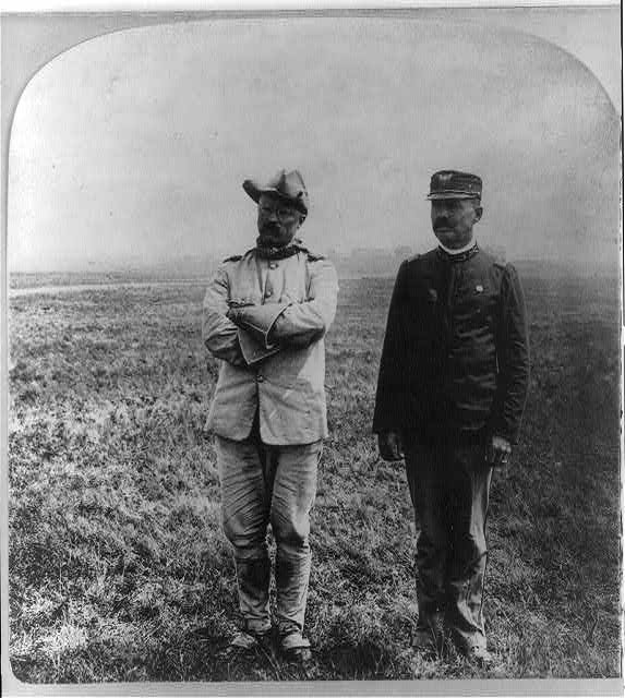 [Theodore Roosevelt, full, standing, with Dr. Cross (in Cav. off. unif.)]