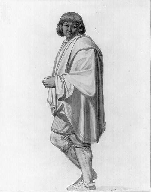 [Full-length portrait of American Indian man with short hair, wearing a blue striped tunic, knee bands, and a white cape]