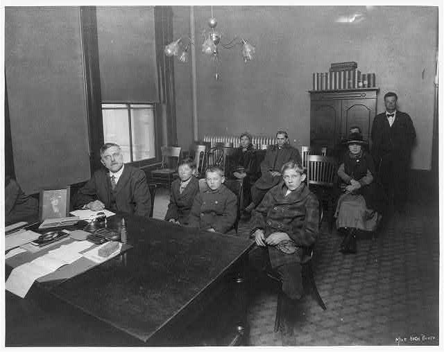 [Judge Ben Lindsey's Juvenile Court chambers; 3 boys and 6 adults shown, Denver, Colorado]