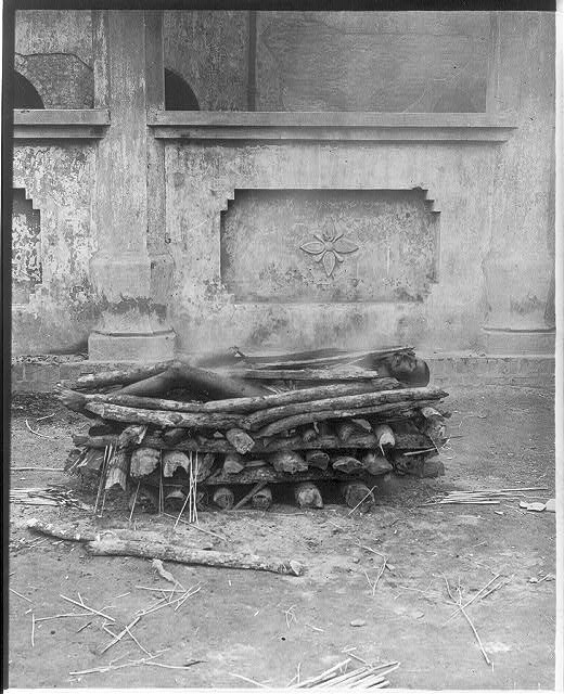 Corpse beginning to burn on pyre, India.  1906.  Library of Congress.