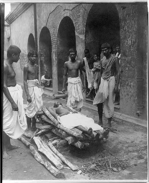 [Corpse placed on funeral pyre, India]