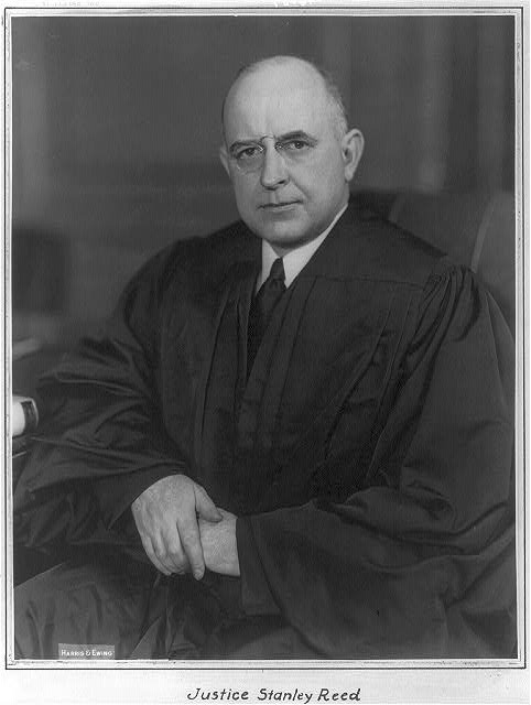 [Justice Stanley Reed, half-length portrait, seated, facing left]