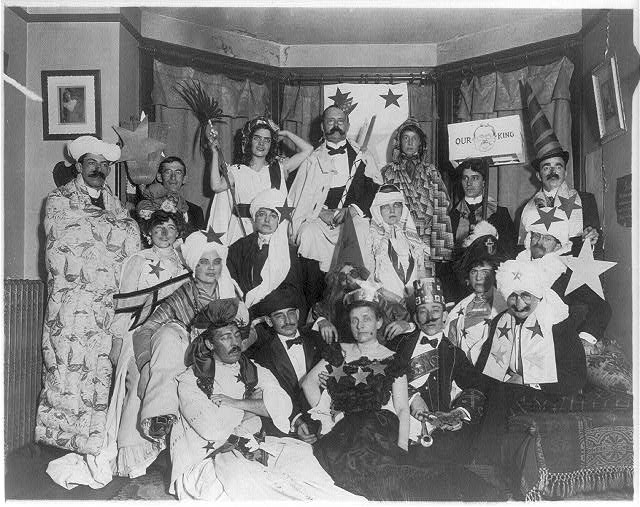[Frances Benjamin Johnston, with friends at costume party, bottom center]