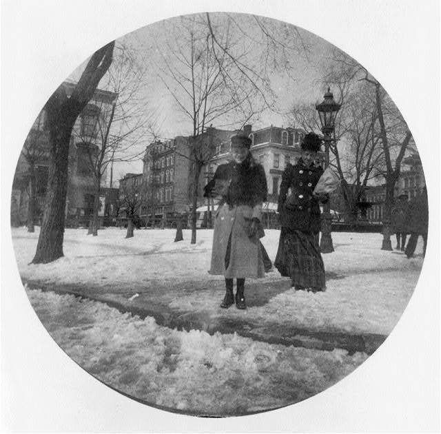 [Woman and girl standing in icy square, Washington, D.C.]