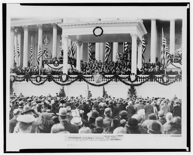 [Chief Justice William H. Taft administering the oath of office to Calvin Coolidge on the east portico of the U.S. Capitol, March 4, 1925]