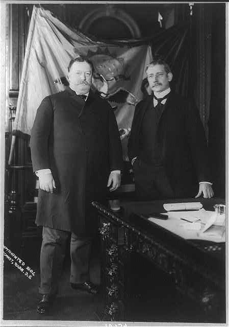 [William Howard Taft, full length, standing, facing slightly right, with Elihu Root]