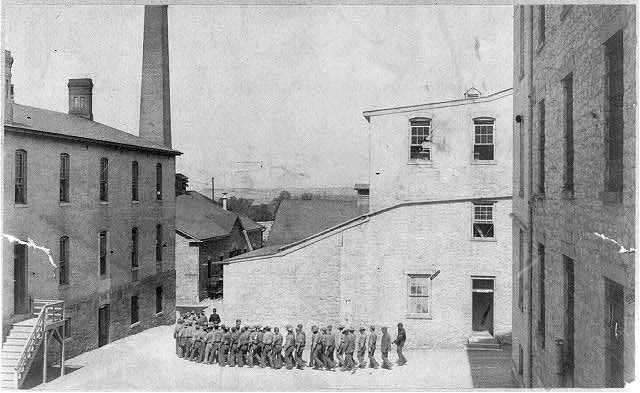 [Photo of prison: prisoners marching to dinner, Leavenworth]