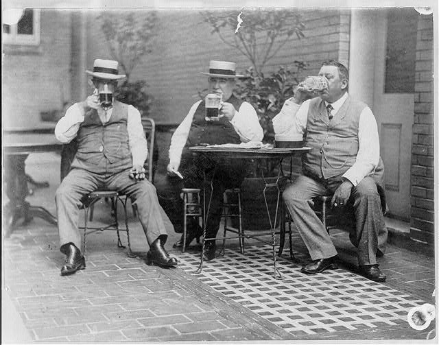 [Three Democratic bosses of Maryland seated and drinking from mugs - L. to R.: George(?) N. Lewis, John S. Kelly, John J. Mahon]
