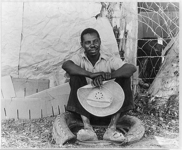 Negro field worker. Holtville, Imperial Valley, California. He has just made himself shoes out of that old tire