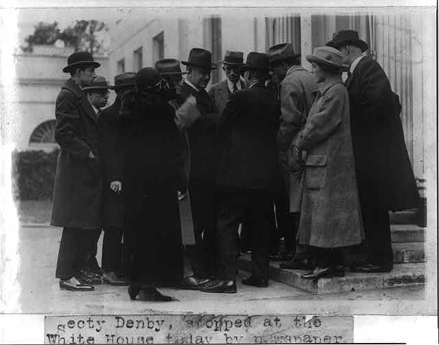 Secretary Denby surrounded by reporters at the White House as he announced he would not resign from the Cabinet as a result of the Tea Pot Dome investigation