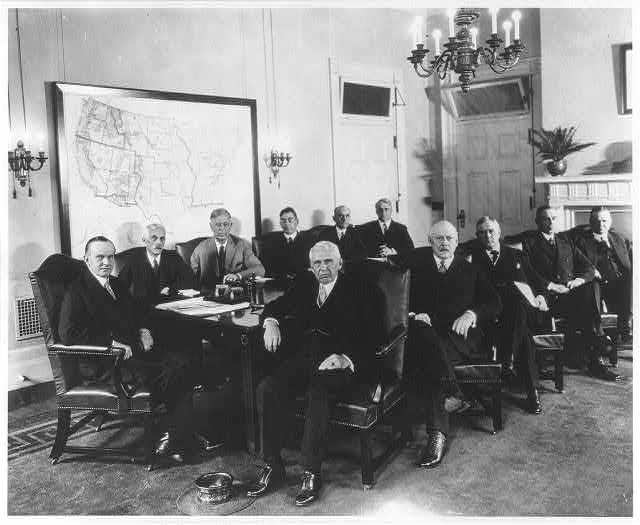 [Calvin Coolidge, full length, seated at head of table, on extreme left of photo, with his cabinet]