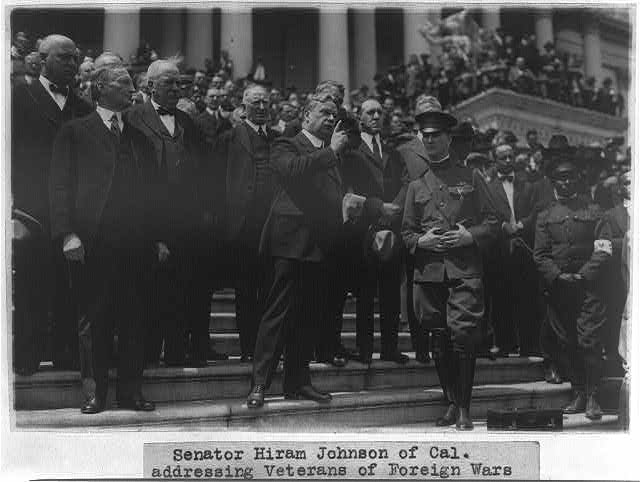 Sen. Hiram Johnson of Calif. on the steps of the U.S. Capitol addressing Veterans of Foreign Wars who presented a bonus petition at the Capitol - prominent in the group are Congressman Fordney, Chairman of the House Ways and Means Committee, and Sen. McCumber, Chairman of the Senate Finance Committee
