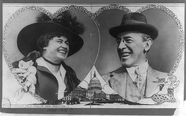 [Woodrow Wilson and Edith Bolling Galt, head-and-shoulders portraits cut in the shape of overlapping hearts with rose border; drawing of cupid in lower right and of the U.S. Capitol which is visible between the hearts]