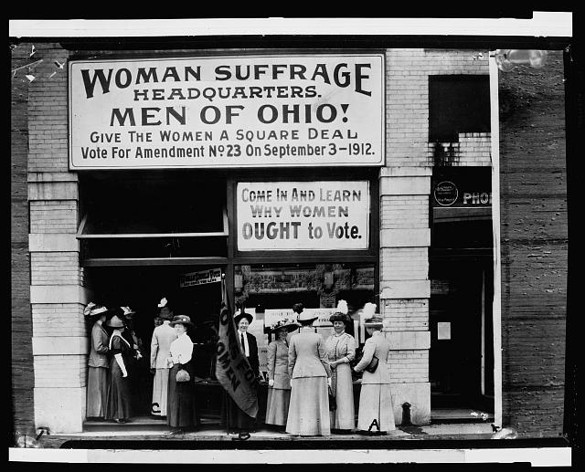 Woman suffrage headquarters in Upper Euclid Avenue, Cleveland--A. (at extreme right) is Miss Belle Sherwin, President, National League of Women Voters; B. is Judge Florence E. Allen (holding the flag); C. is Mrs. Malcolm McBride