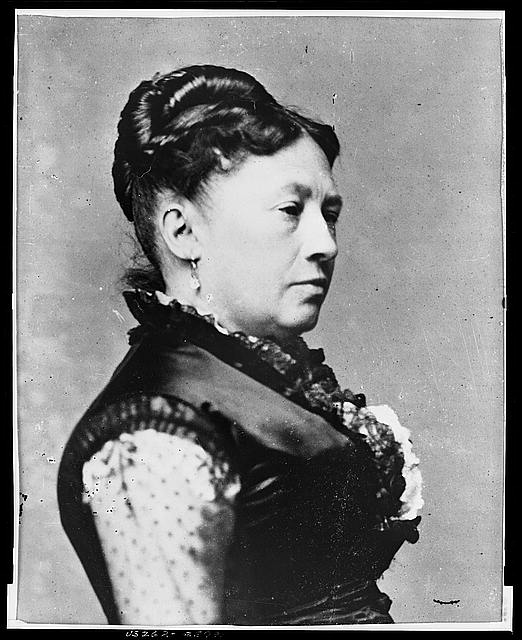 [Mrs. Ulysses S. Grant, full-length portrait, standing, facing right, between table and chair]