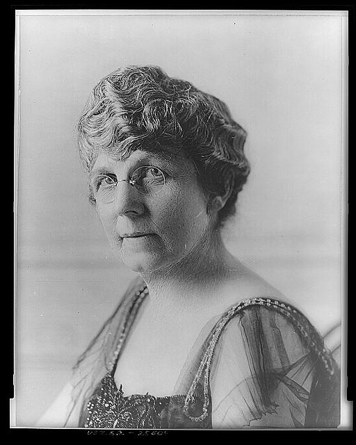 [Mrs. Warren G. Harding, three-quarter length portrait, seated, facing left]
