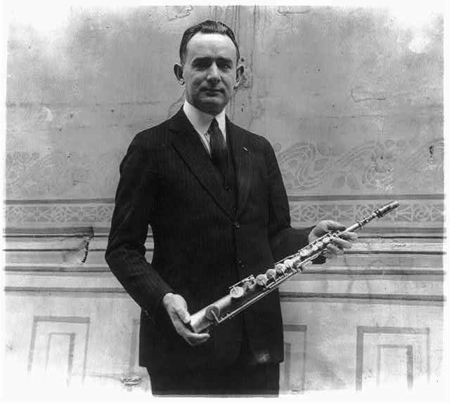 Tomm Brown, who claims to have had the first saxaphone act, posed with 1st saxaphone made by Adolph Sax, the inventor