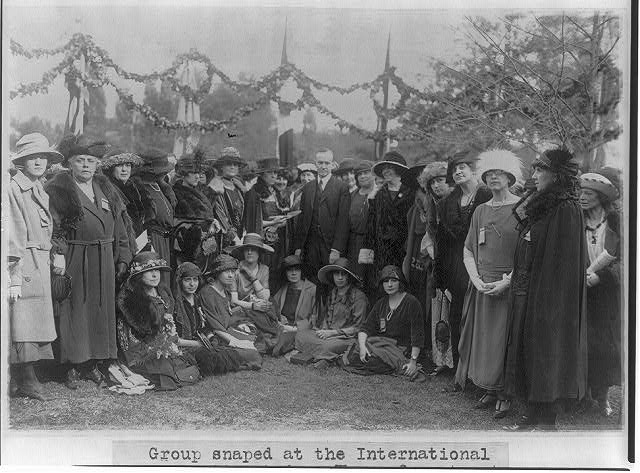 Group at the International Tree Planting, with women from 21 nations who are attending the Pan American Conference of Women, Baltimore, 1922 - in the center of the group are Mrs. Hughes, wife of the Secretary of State, Mrs. Coolidge and Vice President Coolidge