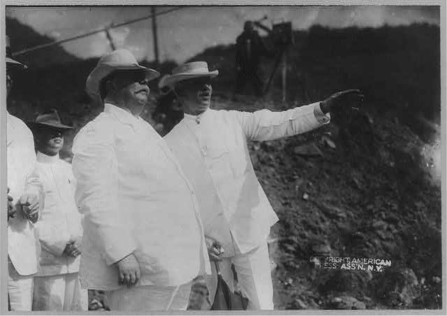 [William Howard Taft, half length, standing, facing right, with Col. George Washington Goethals and others, in Panama]