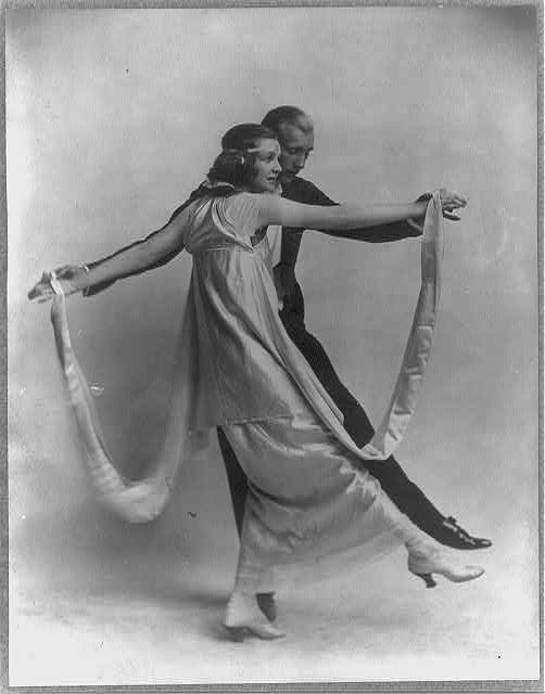 [Vernon Blythe Castle, 1887-1918, and wife, Irene, full length portrait, in dancing pose]