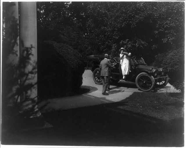 "[Stills of Billie Burke starring in motion picture, ""Gloria's Romance"", 1916: stepping from convertible auto (905)]"