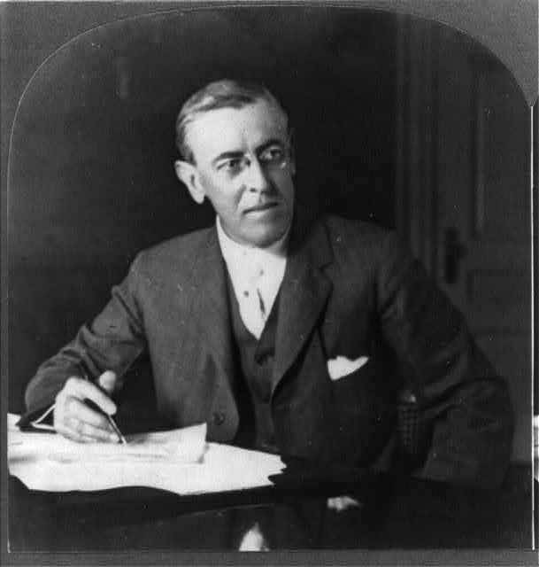 Pres. Woodrow Wilson at his desk, Washington, D.C.