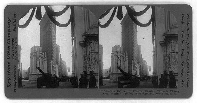 Gun Driven by Tractor, Passing Through Victory Arch, Flatiron Building in Background, New York, N.Y.