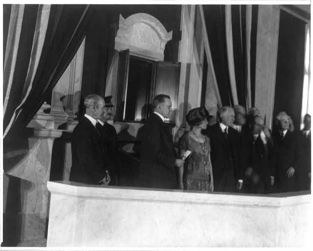 "[President Calvin Coolidge and his wife Grace Goodhue Coolidge at the dedication of the ""shrine"" for public display of the Declaration of Independence and the Constitution in the Great Hall of the Library of Congress. Herbert Putnam, Librarian of Congress, is on the left]"