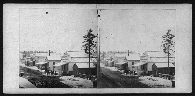 [Street scene showing R. Nelson's General Store, Front St., Marquette, Michigan, with snow on the ground]