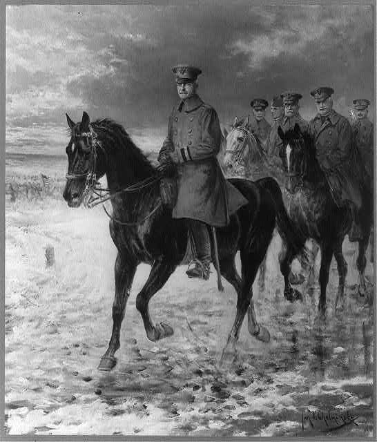 [John Joseph Pershing, 1860-1948, full length, on horseback, facing left, followed by others on horseback, all in uniform]