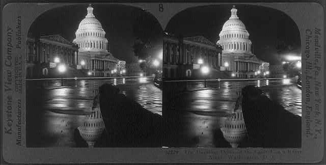 The dazzling dome of the Capitol on a rainy night, Washington, D.C.