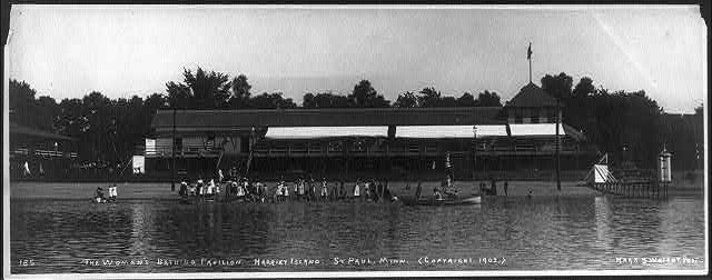 Bathing Pavilions, with people in and out of water: The women's bathing pavilion. Harriet Island, St. Paul, Minn.