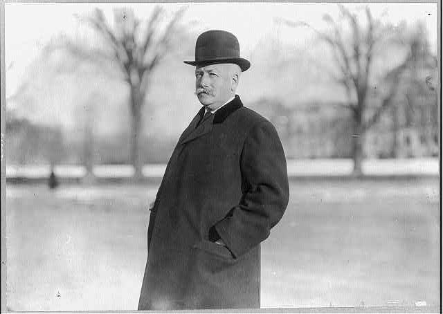 [Charles Grenfill Washburn, 1857-1928, half-length portrait, standing, facing left]