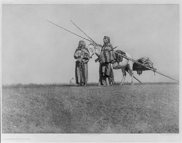 A Blackfoot travois [and 2 Blackfoot Indians]