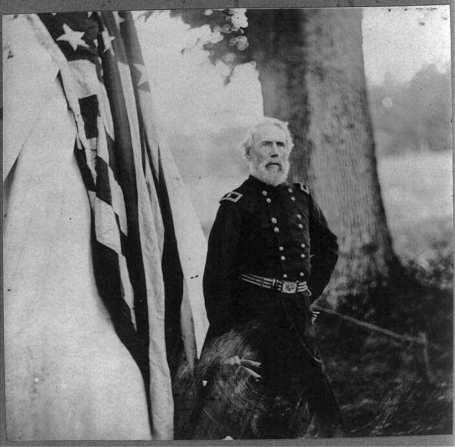 [Maj. Gen. Edwin Vose Sumner, 1797-1863, three-quarter length portrait, standing, facing right, in uniform, outside tent]