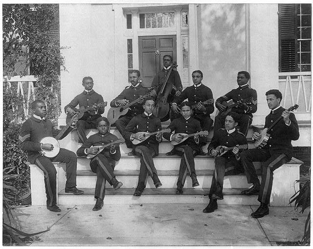 [Hampton Institute, Hampton, Va., ca. 1898 - 11 students in uniform playing guitars, banjos, mandolins, and cello]