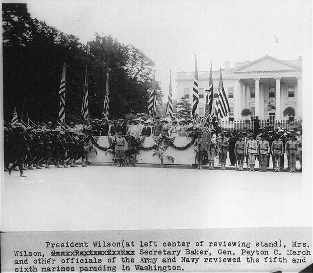 President Wilson, Mrs. Wilson, Secretary [Newton D.] Baker, Gen. Peyton C. March and other officials of the Army and Navy reviewing the fifth and sixth Marines parading in Washington [in front of the White House]