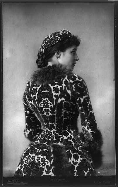 [Lily Langtry, 1852-1929, half length portrait, standing, right profile; in matching turban and dress]