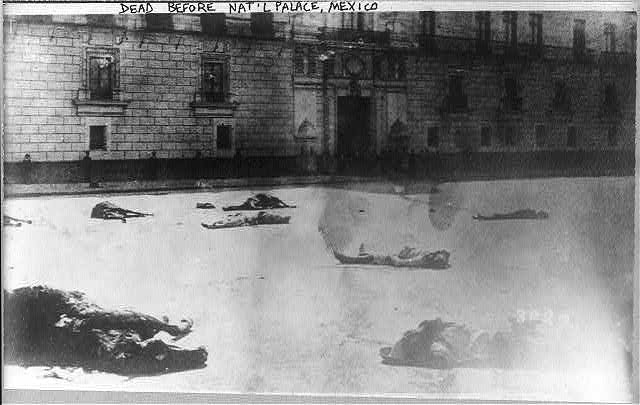 Mexico City - dead men & horses in street before National Palace, Feb. 1933