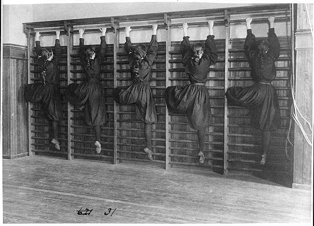 [Girls in bloomers on climbing apparatus, Western High School, Washington, D.C.]