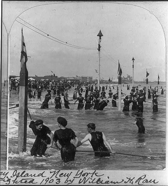 A jolly crowd in the surf, Coney Island, New York