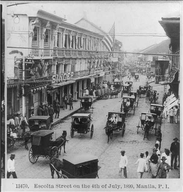 "[Manila, P.I., 1899: ""Escolta St. on the 4th of July""]"