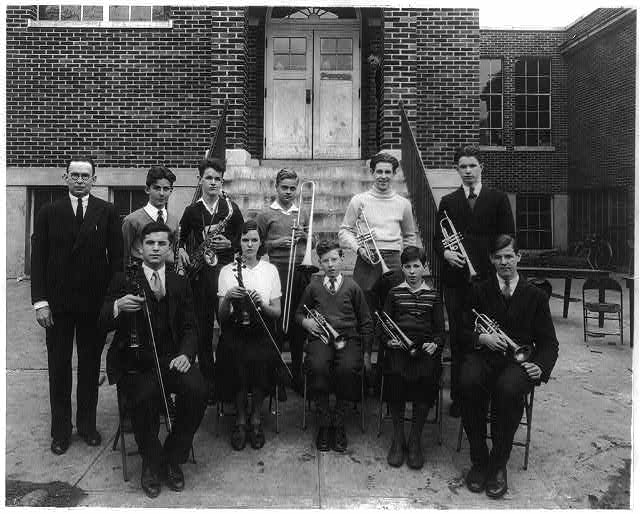 Students at a Washington, D.C. school posed with their teacher and [musical] instruments